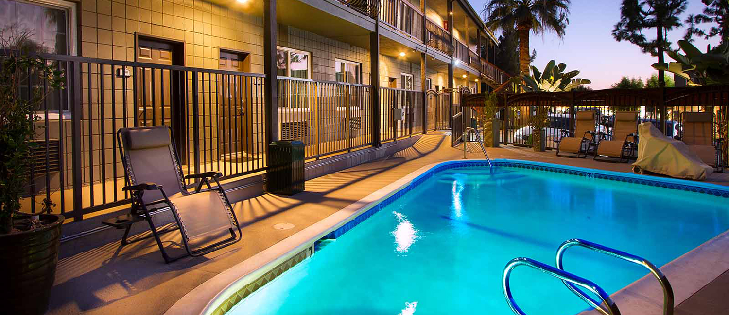 STAY AT THE TOP-RANKED HOTEL GRANADA INN AND ENJOY LUXURIOUS AMENITIES LIKE OUR POOL AND SUNBATHING PATIO